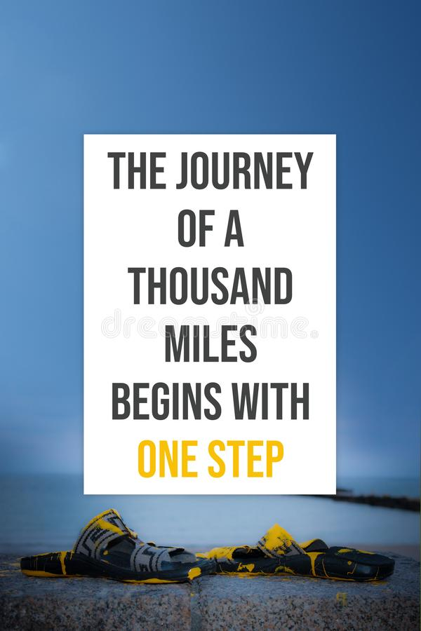 Inspirational poster The journey of a thousand miles begins with one step. Typography floral background concept royalty free stock image