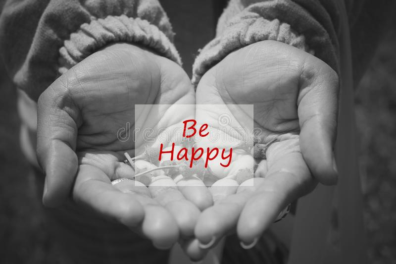 Inspirational quote - Be happy in an open hand in black and white background. Happiness and words of wisdom concept. stock images