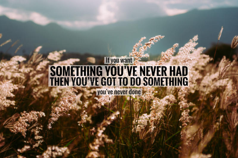 Inspirational quote on Cogon grass field. stock photos