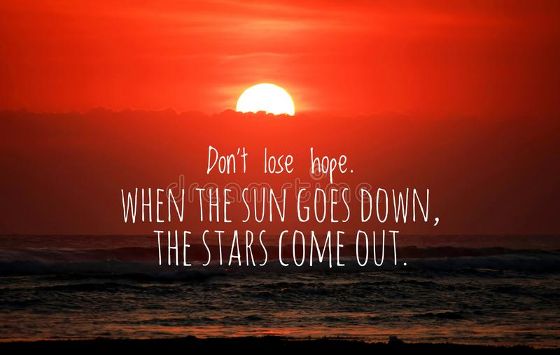 Inspirational quote - Do not lose hope.When the sun goes down, the stars come out. With blurry sunset background over the sea. royalty free stock photos