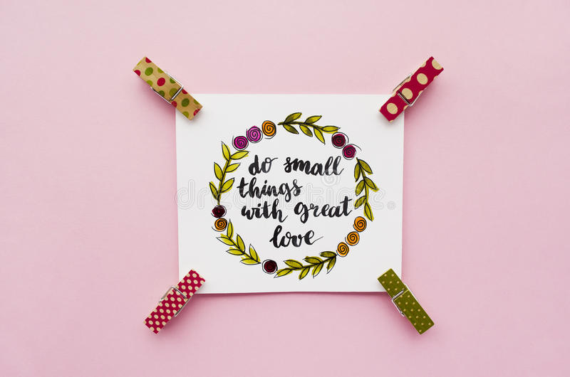 Inspirational quote `do small things with great love` handwritten with watercolor in calligraphy style stock image
