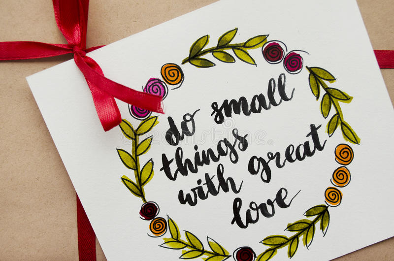 Inspirational quote `do small things with great love` written in calligraphy style royalty free stock photos