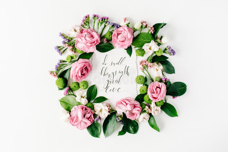 Inspirational quote do small things with great love. Written in calligraphy style on paper with pink, red roses, dried flowers and leaves isolated on white stock image