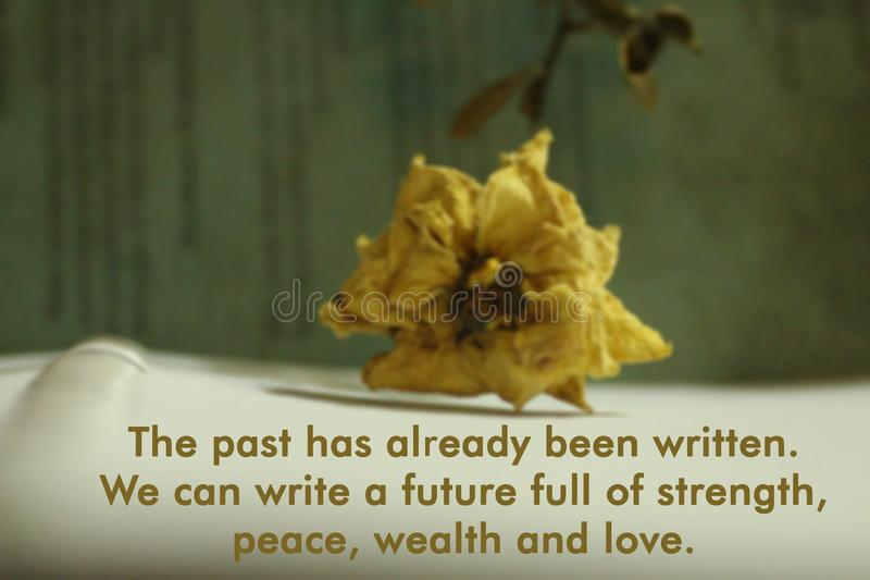 Inspirational quote-The past has already been written. We can write a future full of strength, peace, wealth and love. royalty free stock images
