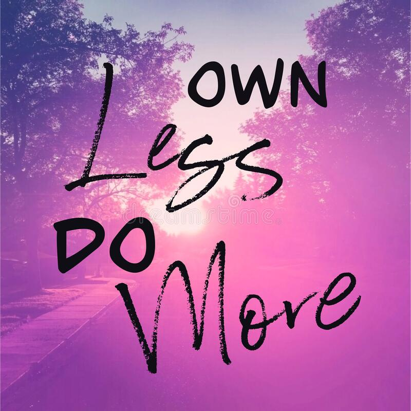 Inspirational Quote - Own Less do More pink Background stock photography