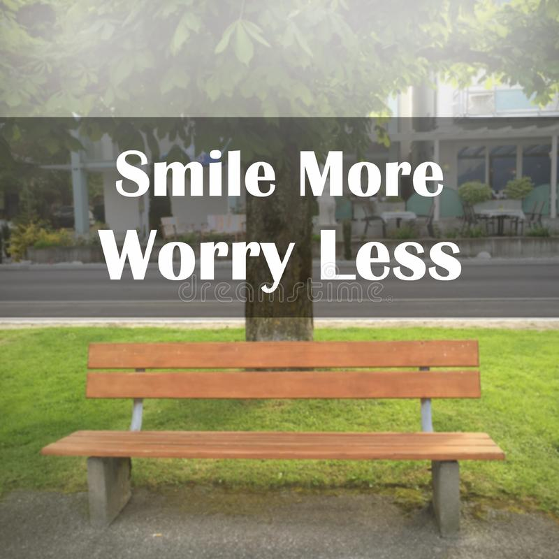 Inspirational quote `Smile more worry less`. On blurred background with vintage filter royalty free illustration