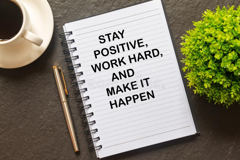 Flat lay of Notebook with Inspirational quote -Stay positive, work hard and make it happen. Inspirational quote - Stay positive, work hard and make it happen royalty free stock image
