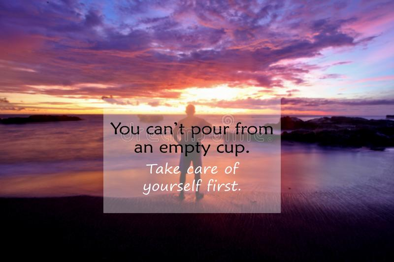 Inspirational quote- You can not pour from an empty cup. Take care of yourself. with blurry image of a man standing looking at the. Beach landscape view and royalty free stock image