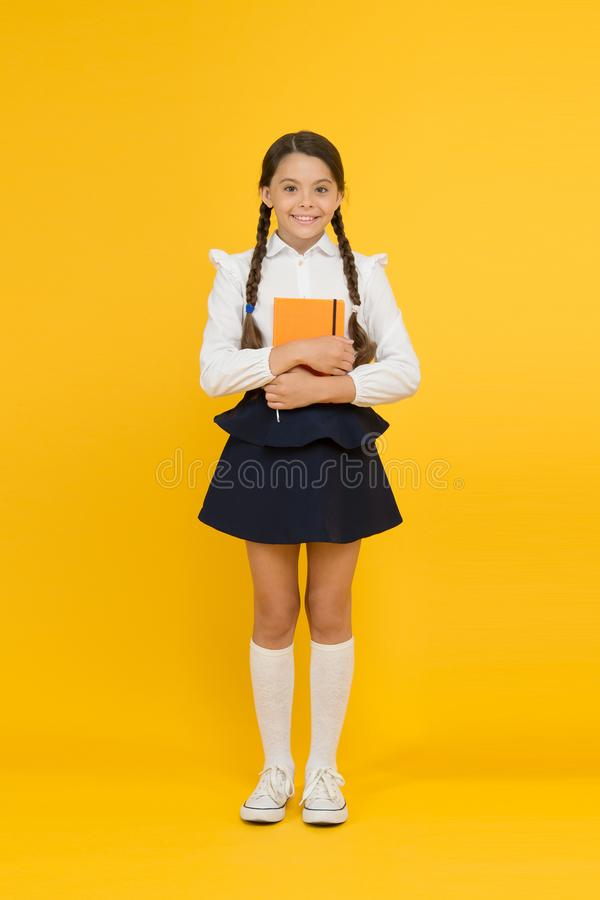Inspirational quotes motivate kids for academic year ahead. School girl formal uniform hold book. School lesson. Study. Literature. Towards knowledge. Learn royalty free stock photos