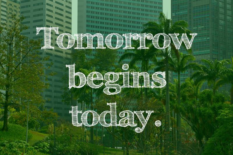 Tomorrow begins today. Inspirational sign - tomorrow begins today. Success motivation stock photo