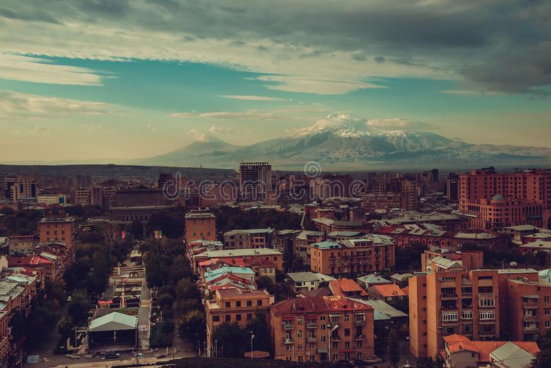 Inspirational Yerevan cityscape. Travel to Armenia. Tourism industry. Mount Ararat on background. Dramatic sky. Armenian architect. Ure. City tour. Urban stock images