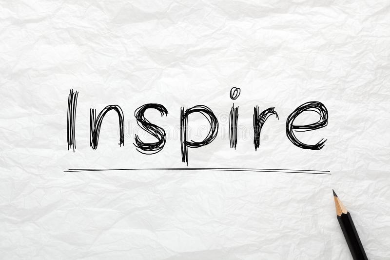 Inspire Highlighted With Pencil. The word Inspire highlighted with pencil on wrinkled lined paper. Business concept stock photos