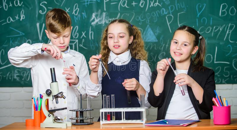 Inspire. Little children. Science. Little kids scientist earning chemistry in school lab. Chemistry science. biology. Experiments with microscope. Lab stock images