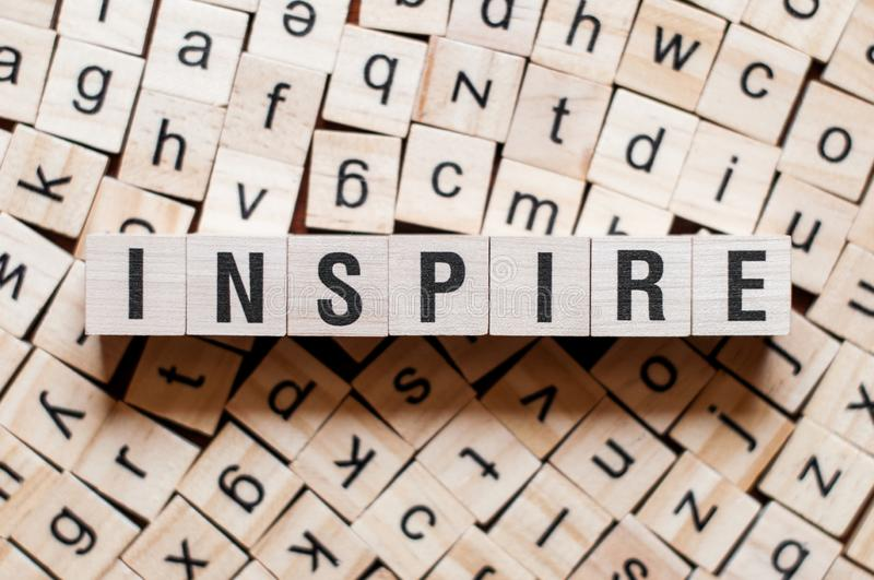 Inspire word concept. On cubes royalty free stock photos