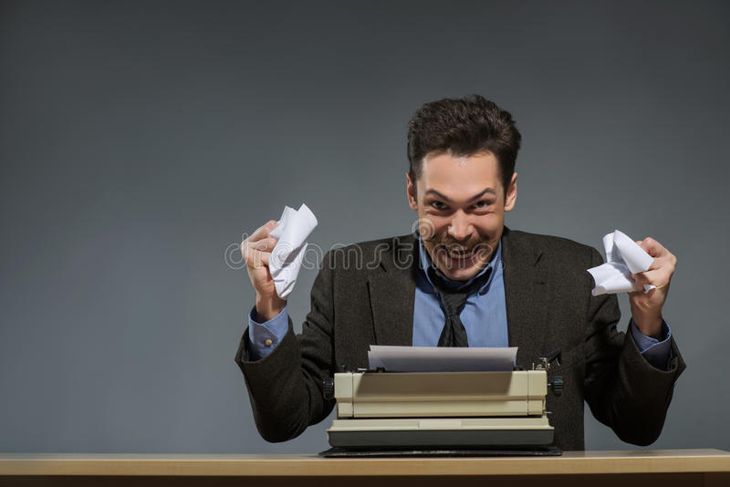 Inspired author throwing crumpled paper stock photo