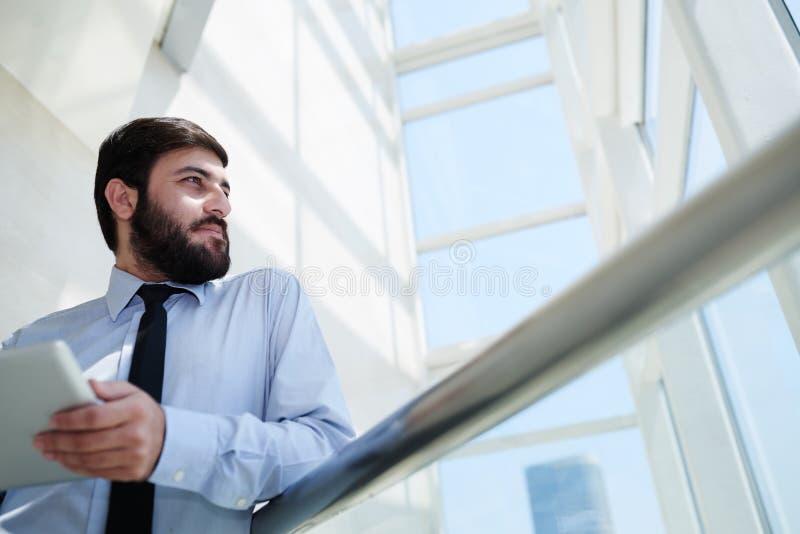 Inspired businessman stock image