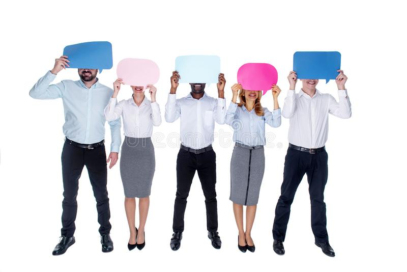 Inspired colleagues covering their faces with tables royalty free stock photos