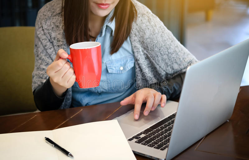 Inspired cup of fresh coffee. young woman holding coffee cup an royalty free stock photo