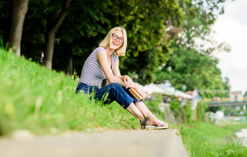 Inspired by novel author. reading is my hobby. Summer study. student girl with book outdoor. interesting story. Relax. And get new information. woman in park stock images