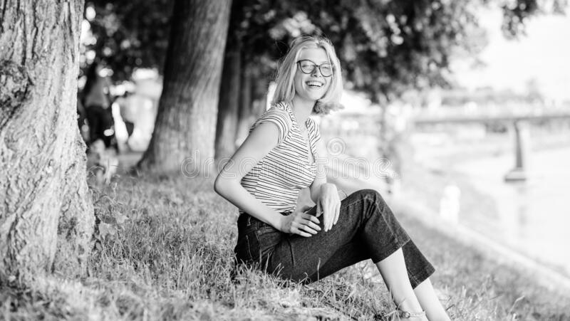 Inspired by novel author. student girl with book outdoor. reading is my hobby. Summer study. interesting story. Relax. And get new information. woman in park stock images
