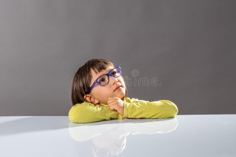 Inspired smart child looking away towards smart future, copy space stock photography