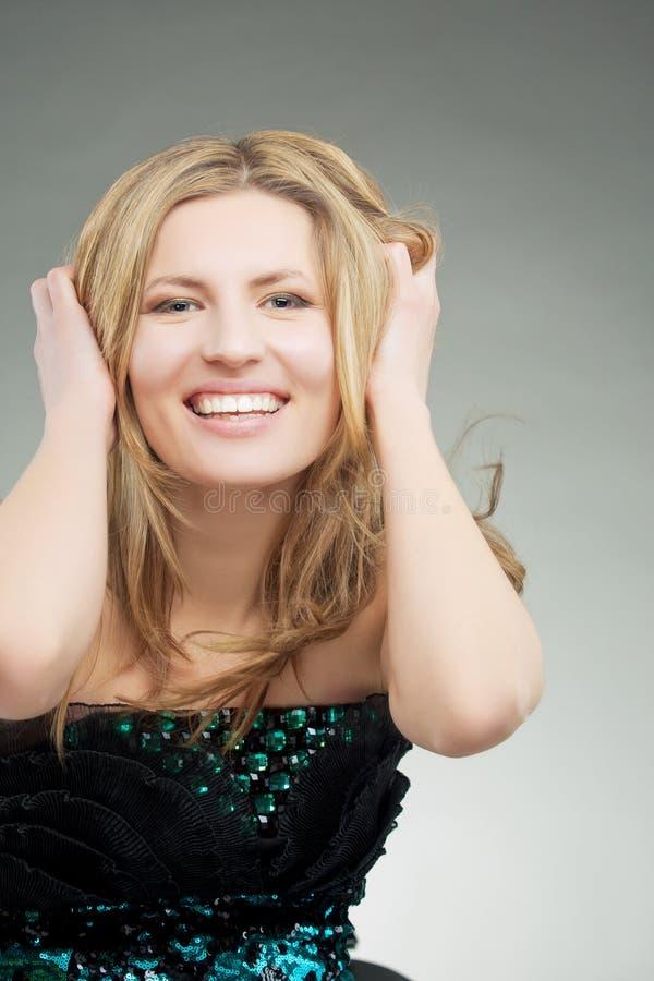 Inspired smiling caucasian blond girl