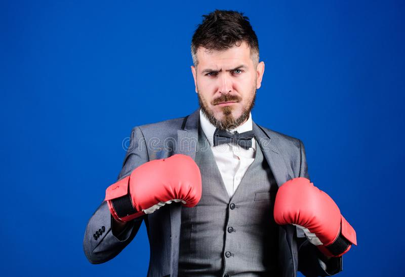 Inspired to work hard. knockout and energy. Fight. bearded man in boxing gloves punching. powerful man boxer ready for. Corporate battle. businessman in formal royalty free stock photos