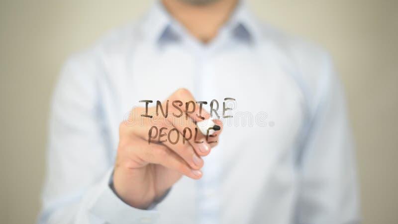 Inspirez les personnes, écriture d'homme sur le mur transparent images stock