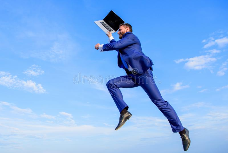 Inspiring innovations. Businessman inspired entrepreneur feels powerful going to change world. Man inspired holds laptop stock images