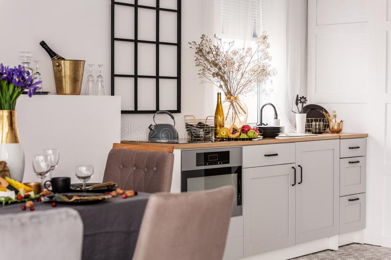 Inspiring kitchen and dining room interior idea with white kitchen furniture. Inspiring kitchen and dining room interior idea with white furniture royalty free stock images