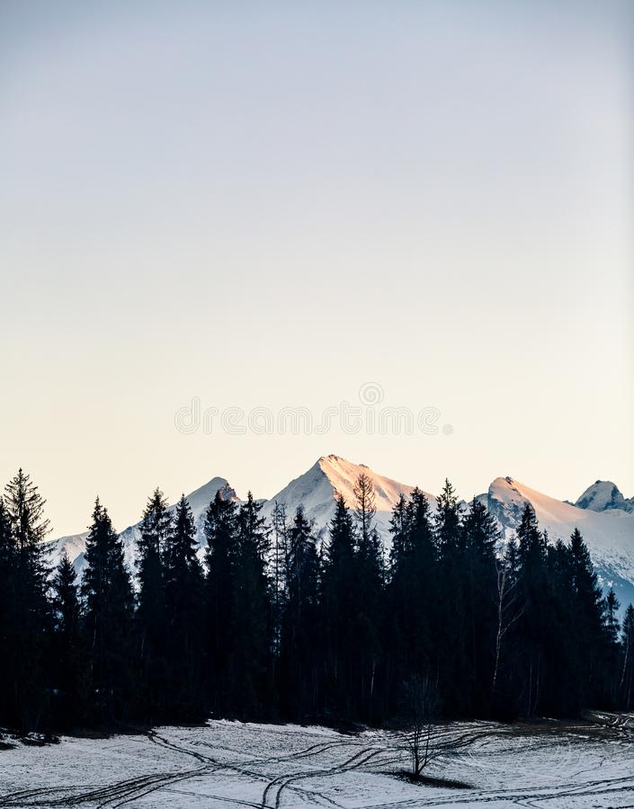 Mountains landscape, sunset in Tatras, Slovakia. Inspiring Mountains landscape in winter Tatras. Looking at high Tatra Mountains at sunset royalty free stock images