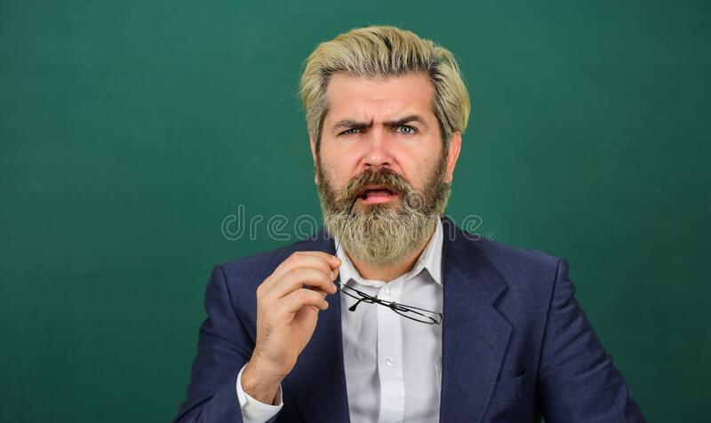 Inspiring quotes. Announcement school courses. Introduced and welcomed by university. Teacher explain topic. Man teacher. In front of school chalkboard copy stock images