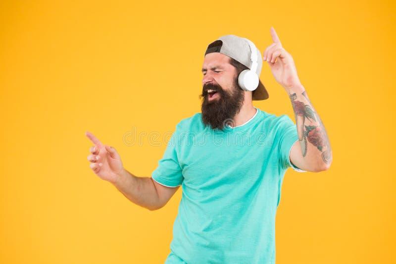 Inspiring song. Music library. Feel rhythm. Bearded guy enjoy music. Equalizer player settings. Lifestyle music fan. Man. Listening music wireless headphones royalty free stock photos