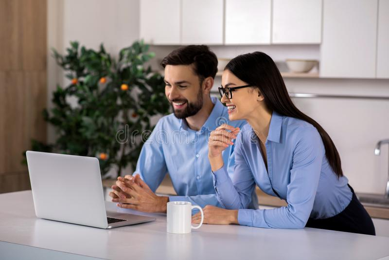 Cheerful business colleagues working in the kitchen royalty free stock image