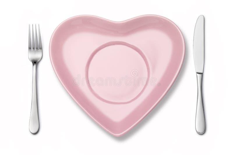 Inställning för kniv för hjärtaplattagaffel royaltyfria bilder