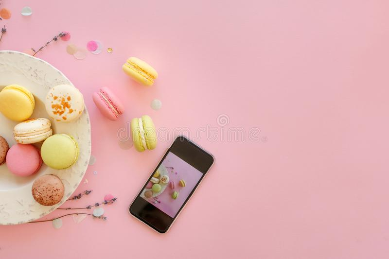 Instagram food photography of tasty colorful macarons in plate a royalty free stock photos