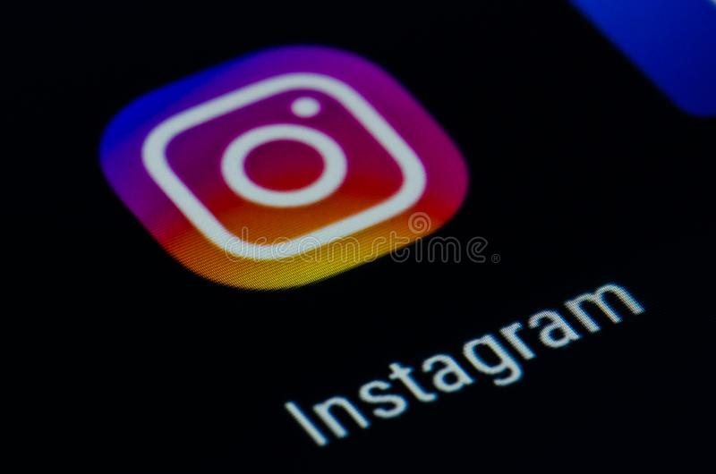 Instagram. Photo and video-sharing social networking service, app on the screen of a smartphone