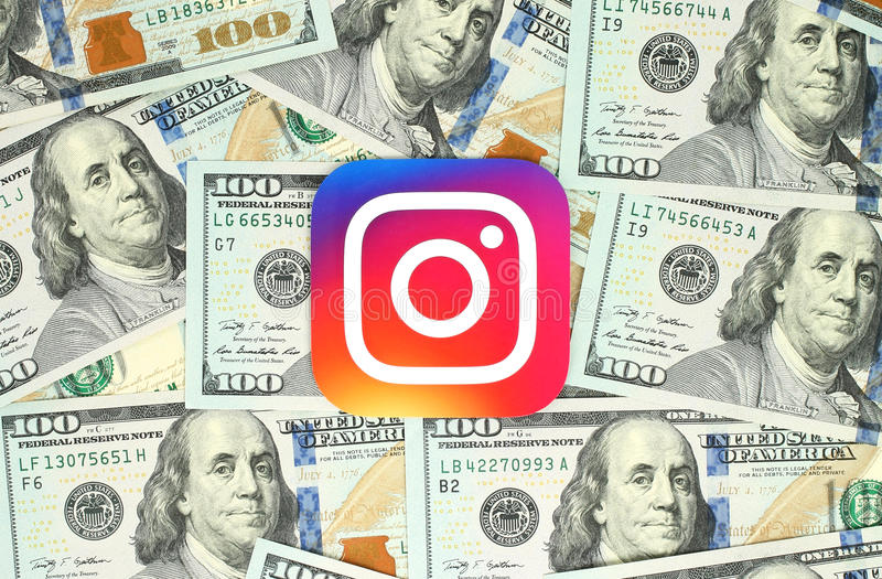 Instagram new logo printed on paper and placed on money background. Kiev, Ukraine - June 13, 2016: Instagram new logo printed on paper and placed on money royalty free stock photos