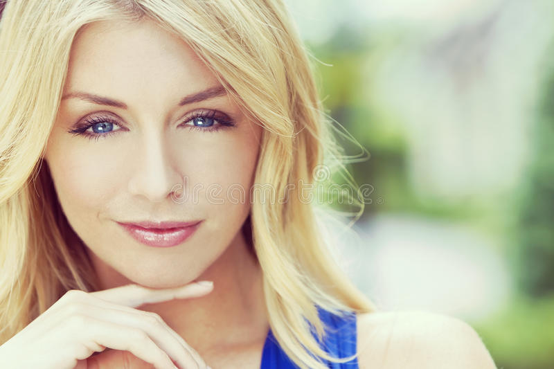 Instagram Style Portrait of Blond Woman With Blue Eyes stock images