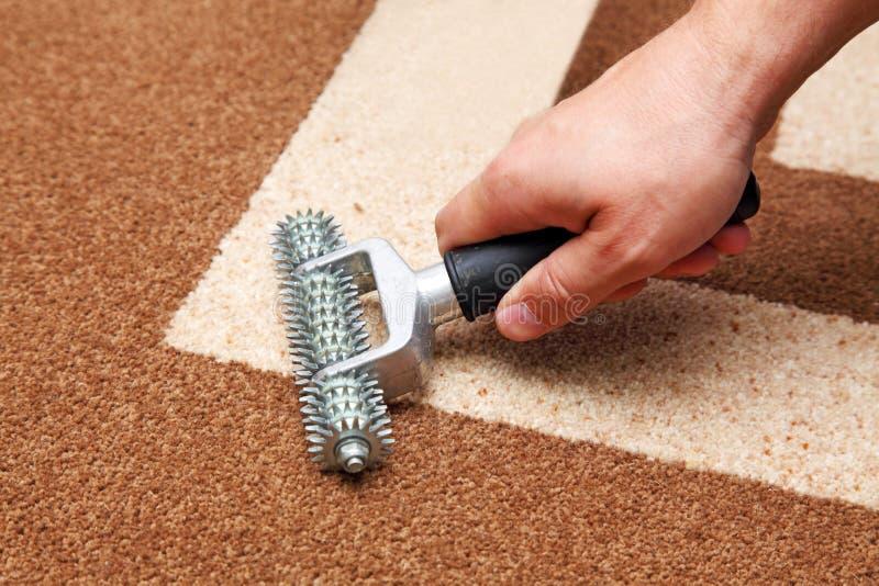 Installatie van tapijt stock fotografie