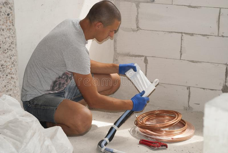 Installation of air conditioning pipes stock image