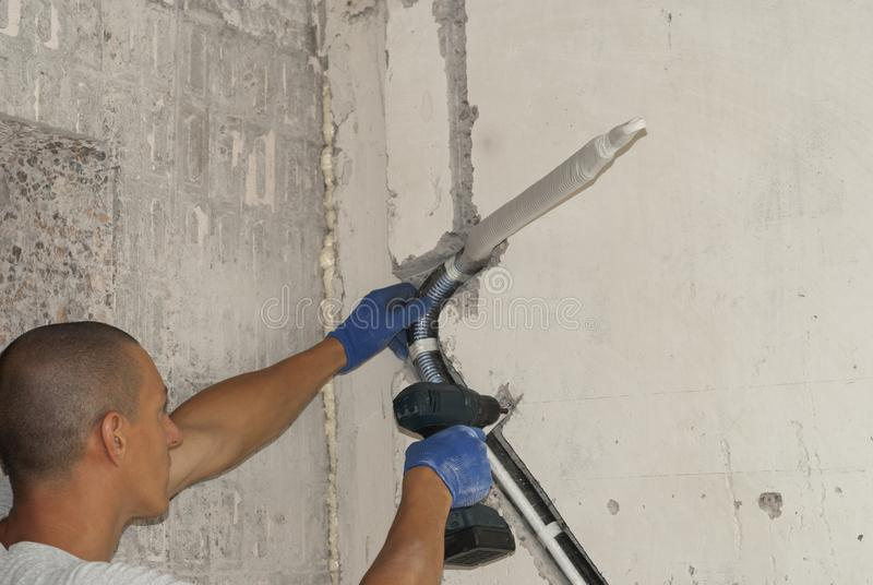 Installation of air conditioning pipes stock photography