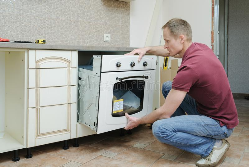 Installation of the built-in electric oven. royalty free stock photo