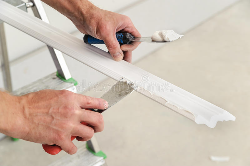 Installation of ceiling moldings. royalty free stock images