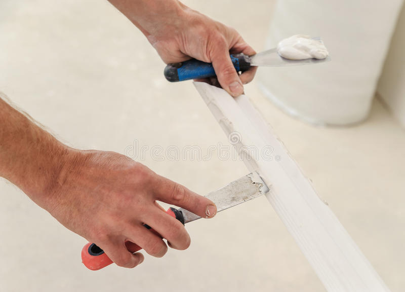 Installation of ceiling moldings. stock image