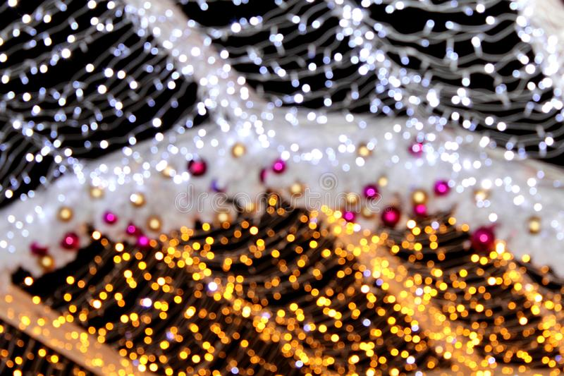 Installation of Christmas decorations in the form of balls of red and gold tones and silver and gold in defocusing, bokeh. royalty free stock images