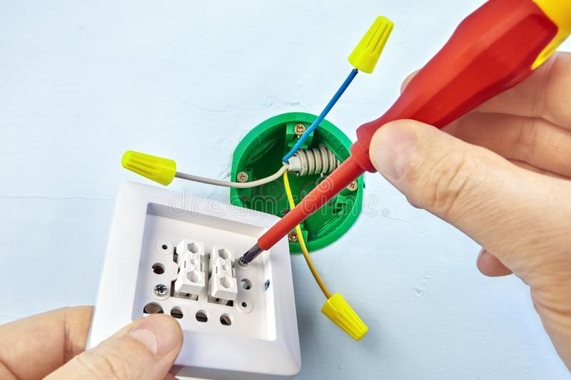 Installation of double light switch stock photos