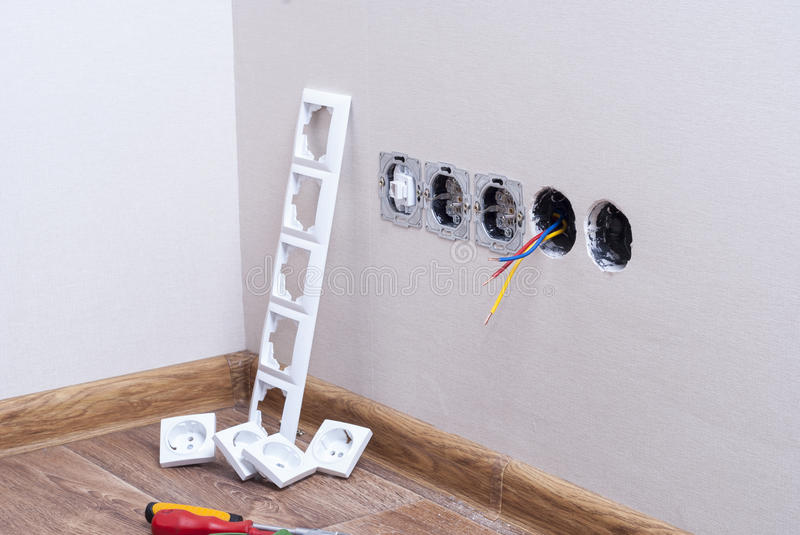 Installation of electrical outlets stock images