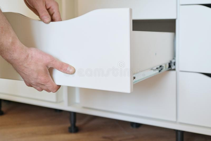 Installation of furniture. Closeup of workers hand and furniture details stock images
