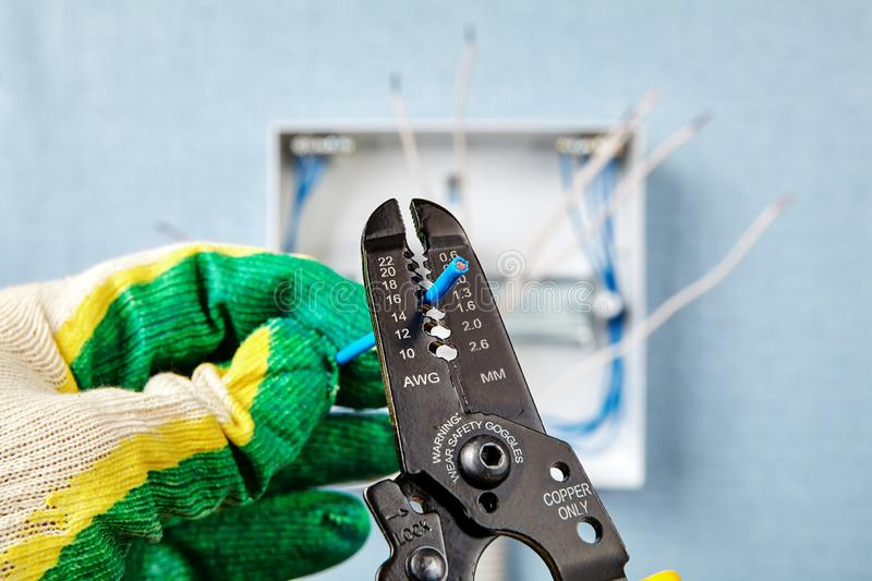 Installation of a household electrical panel stock photos